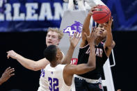 Lamar center David Muoka, right, pulls in a rebound over Abilene Christian center Kolton Kohl (34) and forward Joe Pleasant (32) during the second half of an NCAA college basketball game in the Southland Conference semifinals Friday, March 12, 2021, in Katy, Texas. (AP Photo/Michael Wyke)