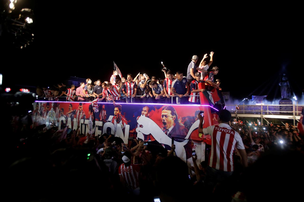 Chivas de Guadalajara team players celebrate with fans at the Minerva monument after winning the Mexican First Division Final in Guadalajara, Mexico May 28, 2017. Picture taken May 28, 2017.  REUTERS/Fernando Carranza