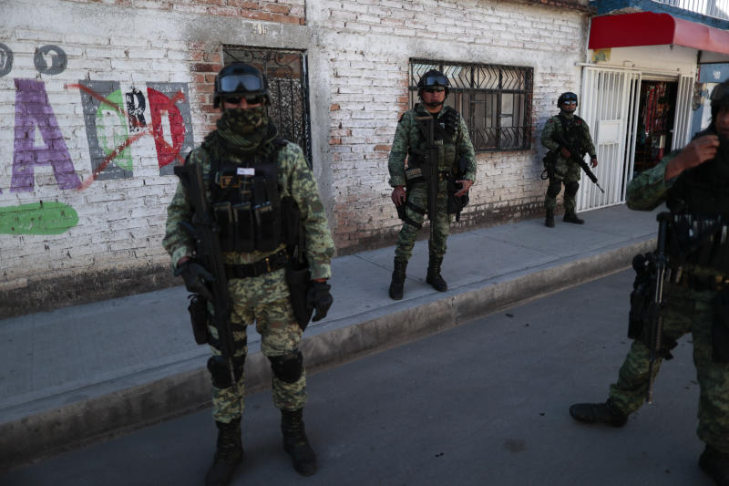 FILE - In this Feb. 12, 2020 file photo, soldiers patrol a neighborhood in Irapuato, Guanajuato state, Mexico. Mexico's drug war has long played out in dusty northern border cities or the poppy fields of its southern mountains, but now the killings have moved to the conservative industrial heartland state of Guanajuato. (AP Photo/Rebecca Blackwell, File)