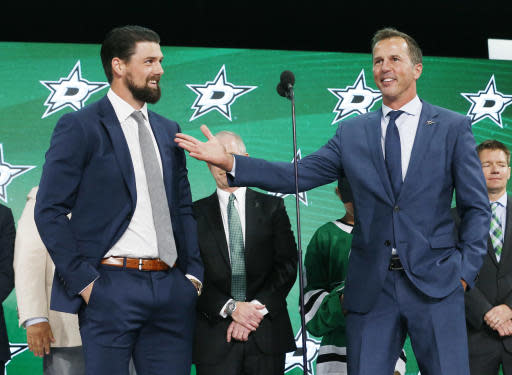 Dallas Stars forward Jamie Benn, left, and retired Dallas Star Mike Modano stand on stage during the NHL hockey draft in Dallas, Friday, June 22, 2018. (AP Photo/Michael Ainsworth)