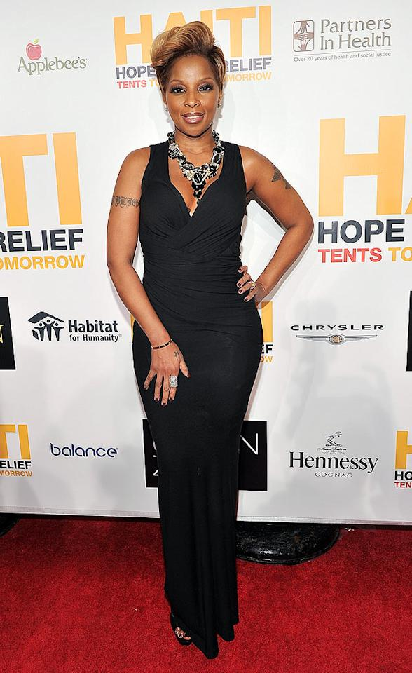"Back in NYC, the Queen of Hip-Hop Soul, Mary J. Blige, popped a regal pose in a curve-hugging gown and statement necklace upon arriving at a Haiti relief charity event. Theo Wargo/<a href=""http://www.wireimage.com"" target=""new"">WireImage.com</a> - February 8, 2010"