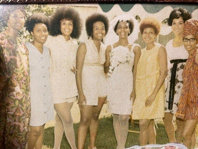 """Ethel Sawyer is joined at her wedding in St. Louis in 1971 by other former Tougaloo College students  From the left Dorie Ladner,  Joyce Ladner, Ethel Sawyer and Janice Jackson.  Sawyer and Jackson were among the nine Tougaloo students who staged a """"read-in'' at a whites-only library in 1961 in Jackson, Mississippi. The Ladner sisters went on to work with the Student Nonviolent Coordinating Committee. (Photo courtesy of Ethel Sawyer)"""
