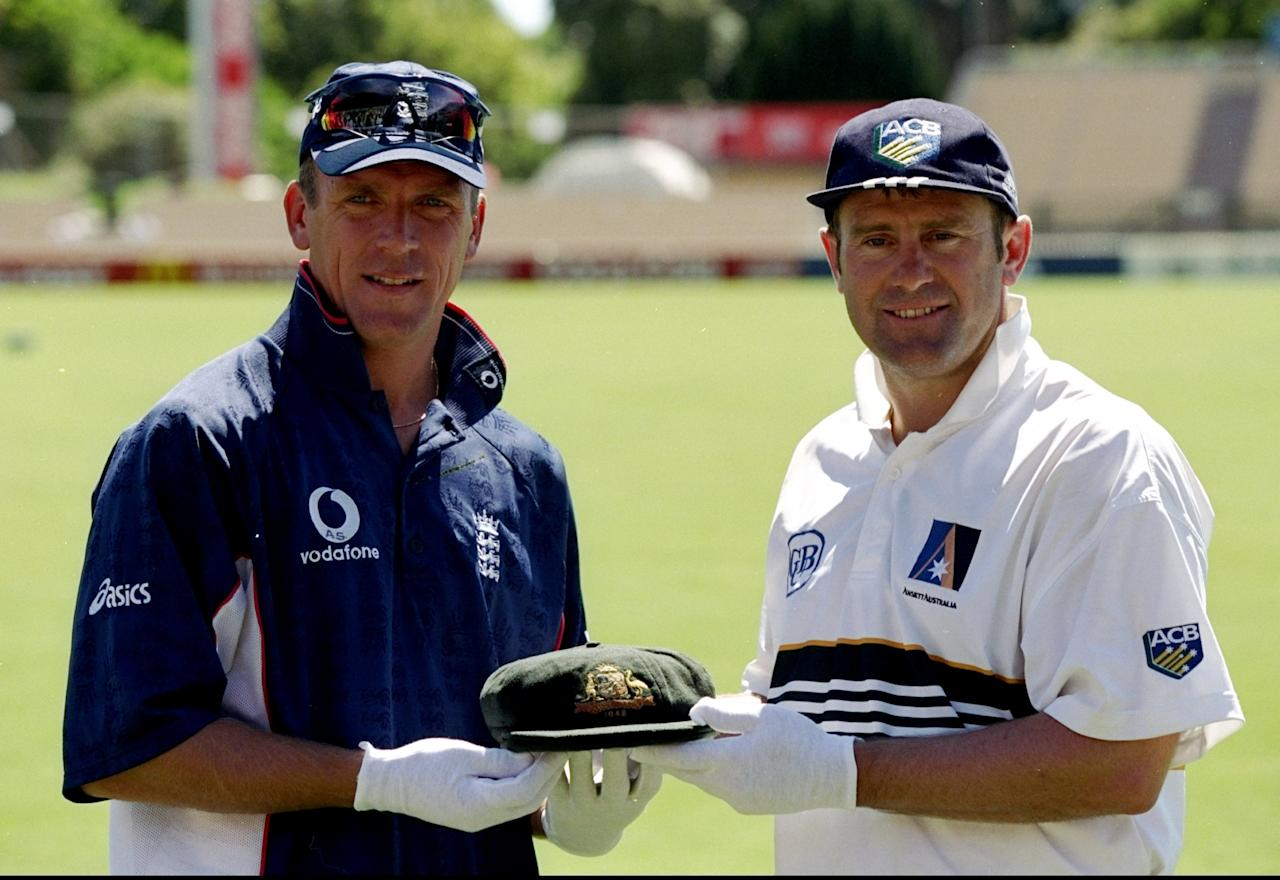 10 Dec 1998:  Captains Alec Stewart of England and Mark Taylor of Australia hold an 1948 Australian cap the before the Third Ashes Test against England at the Adelaide Oval in Adelaide, Australia. Australia retained the Ashes. \ Mandatory Credit: LaurenceGriffiths /Allsport