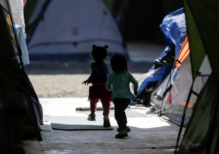 Migrant girls, asylum seekers sent back to Mexico from the U.S. under the Remain in Mexico program officially named Migrant Protection Protocols (MPP), are seen playing at a provisional campsite near the Rio Bravo in Matamoros