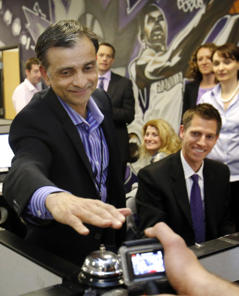 Vivek Ranadive, the new majority owner of the Sacramento Kings NBA basketball team, rings a bell after a season ticket holder he called pledged to renew their seats for next season, during his visit to the team's offices at Sleep Train Arena in Sacramento, Calif., Thursday, May 23, 2013. Ranadive joined employees in calling season ticket holders to encourage them to renew their tickets for next season. (AP Photo/Rich Pedroncelli)