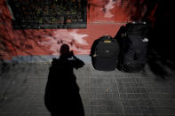 Associated Press Photographer Natacha Pisarenko photographs her luggage in Buenos Aires, Argentina, Saturday, July 17, 2021, before heading to the airport to begin her roughly 35 hour journey to cover the 2020 Summer Olympics in Tokyo. (AP Photo/Natacha Pisarenko)