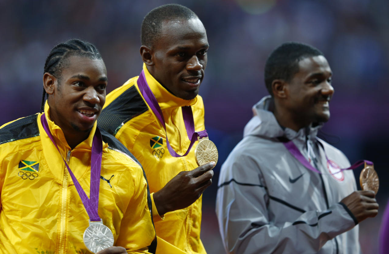 Gold medallist Jamaica's Usain Bolt poses with silver medallist Jamaica's Yohan Blake (L) and bronze medallist Justin Gatlin of the U.S.  (R) during the men's 100m victory ceremony at the London 2012 Olympic Games at the Olympic Stadium August 6, 2012.           REUTERS/Eddie Keogh (BRITAIN  - Tags: OLYMPICS SPORT ATHLETICS)