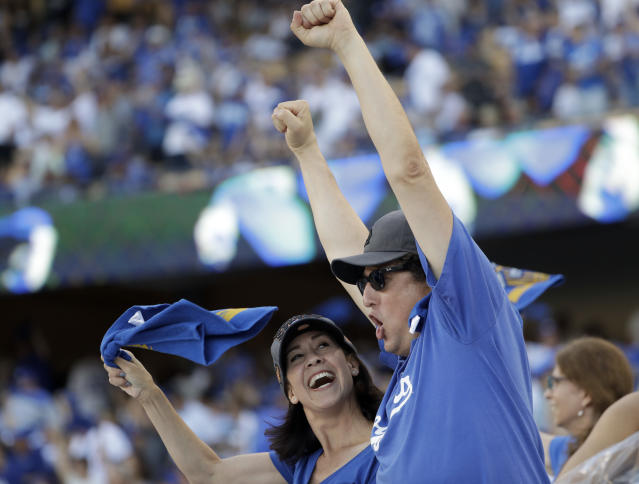 Fans cheer before Game 1 of baseball's World Series between the Los Angeles Dodgers and the Houston Astros Tuesday, Oct. 24, 2017, in Los Angeles. (AP Photo/Matt Slocum)