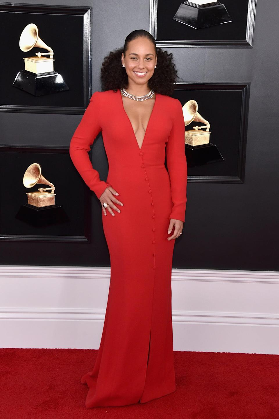<p>Wearing a red plunging gown with Bulgari jewels and Aquazzura shoes.</p>