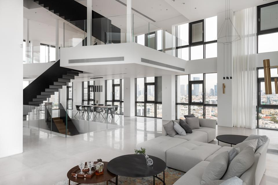 Central to the open plan space is a steel staircase. Photo: Beauchamp Estates
