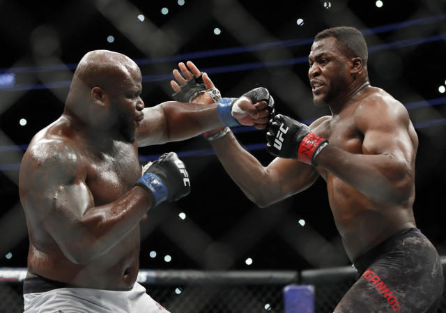Francis Ngannou, right, fights Derrick Lewis during a heavyweight mixed martial arts bout at UFC 226, Saturday, July 7, 2018, in Las Vegas. (AP)