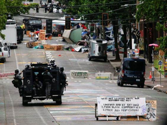 Seattle police brings in teams to clear the area 'ceded' to demonstrators (Reuters)
