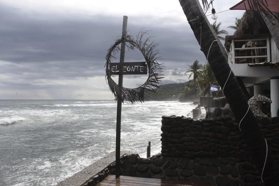Restaurants overlook El Zonte beach in Tamanique, El Salvador, Wednesday, June 9, 2021. In this beach community, a nongovernmental organization with the financial backing of an anonymous Bitcoin donor has been trying to create a small-scale cryptocurrency economy, and could serve as a showcase for the gains and struggles to introduce a phone-based cryptocurrency as the country embarks on a nationwide experiment after making Bitcoin legal tender this week. (AP Photo/Salvador Melendez)