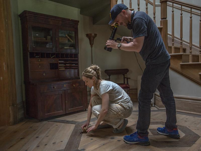 "Jennifer Lawrence and Darren Aronofsky film a scene from ""mother!"" (Paramount Pictures)"