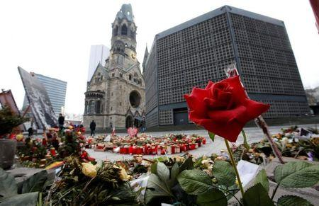 Flowers and candles are pictured at the site where on December 19, 2016 a truck ploughed through a crowd at a Christmas market on Breitscheidplatz square in Berlin