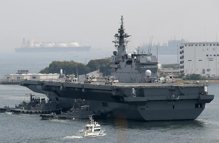"""Japan's new five-year defence plan calls for the military to upgrade two existing """"helicopter carriers"""" so that they will also be able to launch fighter jets (AFP Photo/STR)"""