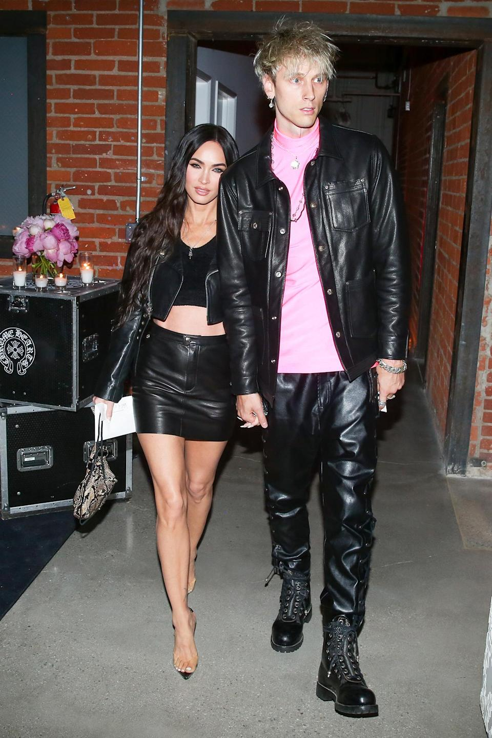 <p>Megan Fox and Machine Gun Kelly step out in coordinating leather outfits to celebrate Jesse Jo Host's Sugar Jones Collection for Chrome Hearts at a dinner in L.A. on June 10. </p>