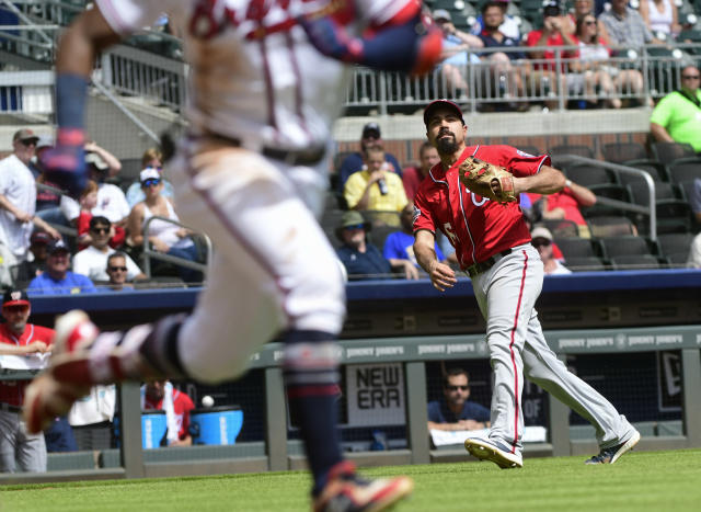 Washington Nationals third baseman Anthony Rendon watches his throw to first base as he throws out Atlanta Braves left fielder Ronald Acuna Jr., left, during the third inning of a baseball game Saturday, Sept. 15, 2018, in Atlanta. (AP Photo/John Amis)