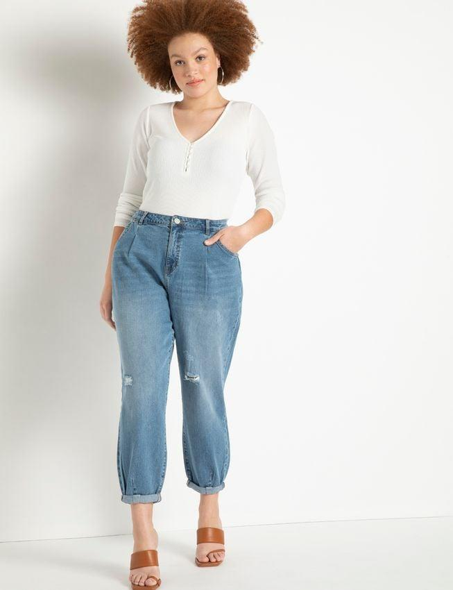 <p><span>Eloquii Pleat Front Relaxed Jeans with Roll Cuff</span> ($100)</p>