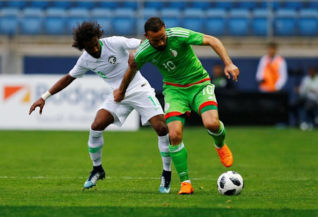Soccer Football - International Friendly - Saudi Arabia v Algeria - Estadio Ramon de Carranza, Cadiz, Spain - May 9, 2018 Saudi Arabia's Yasser Al-Shahrani in action with Algeria's Ali Lakroum REUTERS/Marcelo Del Pozo
