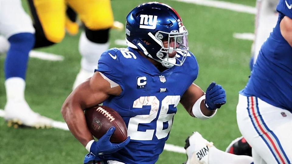 Sep 14, 2020; East Rutherford, New Jersey, USA; New York Giants running back Saquon Barkley (26) carries the ball against the Pittsburgh Steelers as offensive guard Kevin Zeitler (70) blocks during the second half at MetLife Stadium. Mandatory Credit: Vincent Carchietta-USA TODAY Sports