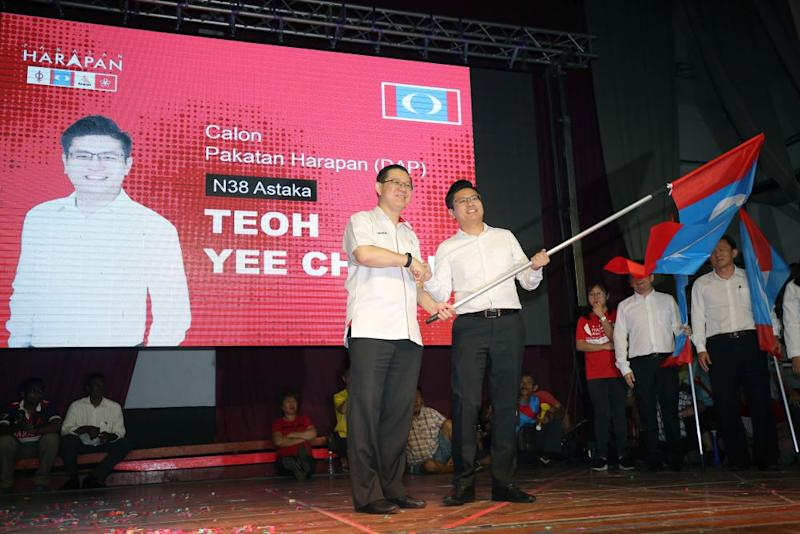 Teoh (right) will be contesting the Astaka (formerly Sitiawan) state seat in GE14. — Picture by Marcus Pheong
