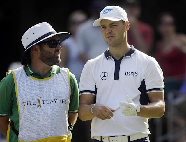 Martin Kaymer, right, of Germany, talks to his caddie Craig Connelly before hitting from the eighth tee during the first round of The Players championship golf tournament at TPC Sawgrass, Thursday, May 8, 2014 in Ponte Vedra Beach, Fla. (AP Photo/Gerald Herbert)