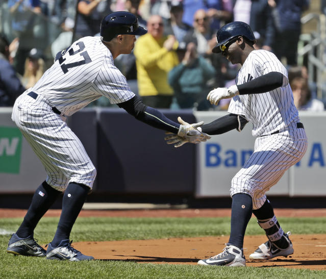 New York Yankees' Didi Gregorius, right, celebrates his solo home run with Giancarlo Stanton during the first inning of the baseball game against the Toronto Blue Jays at Yankee Stadium Sunday, April 22, 2018 in New York. (AP Photo/Seth Wenig)
