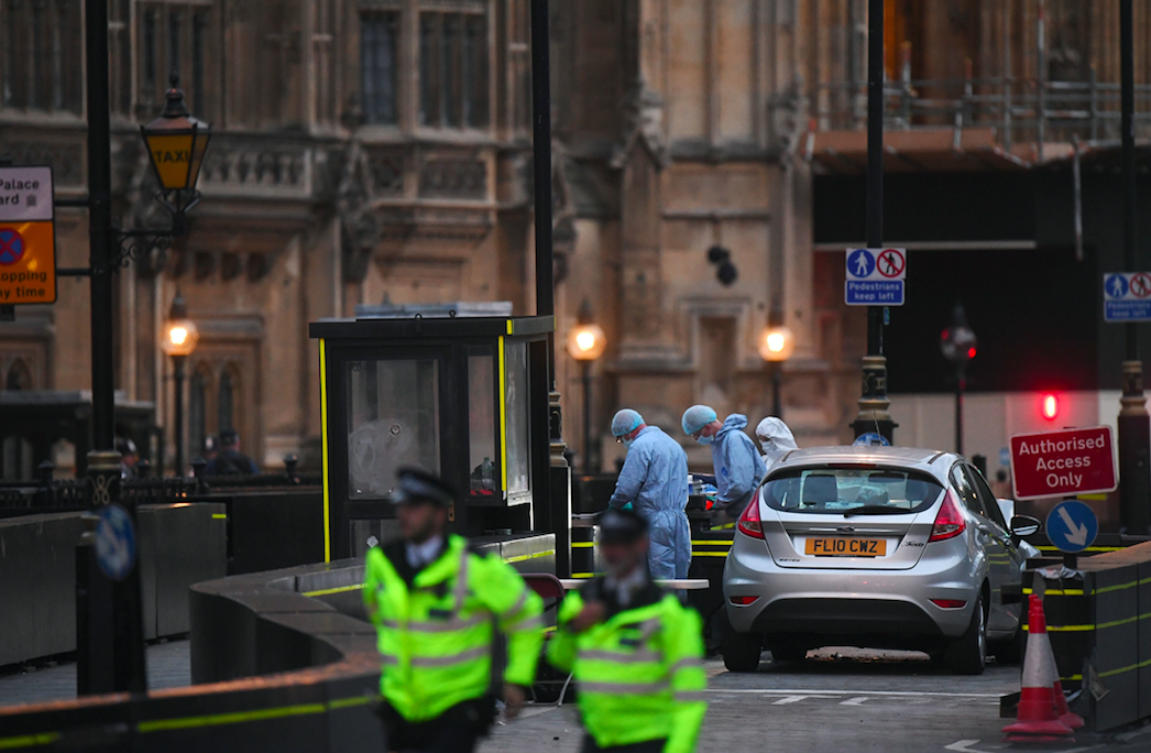 <em>Police and forensic teams surround the car used in the attack (PA)</em>