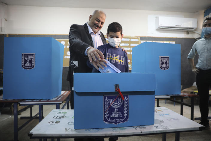 Mansour Abbas, leader of the United Arab List, votes for Israel's parliamentary election at a polling station in Maghar, Israel, Tuesday, March. 23, 2021. Israel is holding its fourth election in less than two years. (AP Photo/Mahmoud Illean)