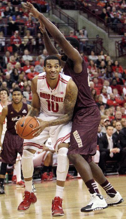 Ohio State's LaQuinton Ross, left, grabs a rebound from Louisiana-Monroe's Evan Sims during the second half of an NCAA college basketball game, Friday, Dec. 27, 2013, in Columbus, Ohio. Ohio State defeated Louisiana-Monroe 71-31. (AP Photo/Jay LaPrete)