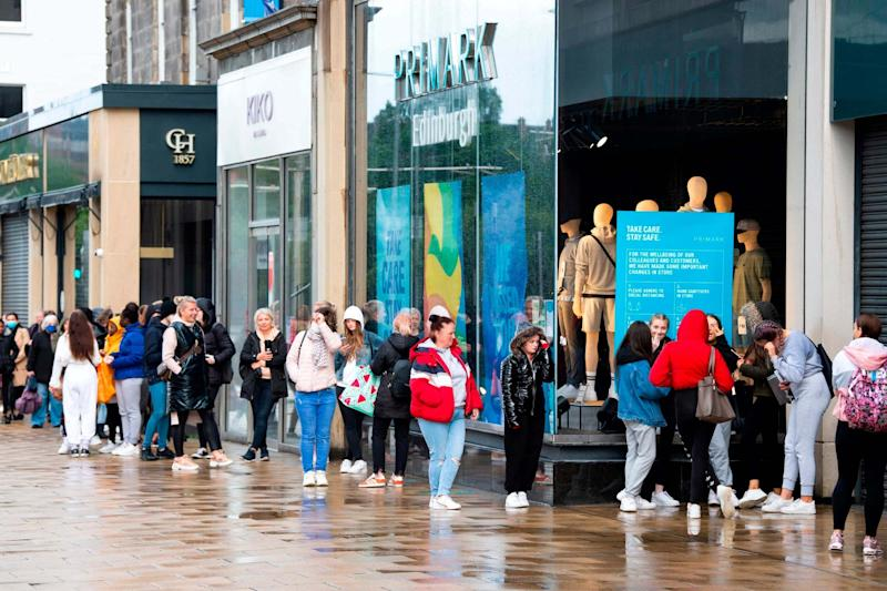 Customers queue outside the Primark store on Princes Street in Edinburgh: AFP via Getty Images