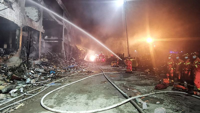 In this photo released by Xinhua News Agency, firefighters work at the site of buildings damaged after a tanker truck explosion on a highway in Wenling. Source: AP