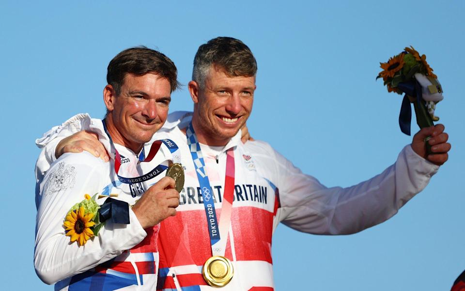 Dylan Fletcher (L) and Stuart Bithell of Team Great Britain pose with their gold medals for the Men's Skiff 49er - Getty Images