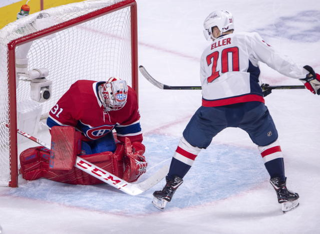 Montreal Canadiens goaltender Carey Price (31) makes the save on Washington Capitals centre Lars Eller (20) during second period NHL hockey action Monday, Nov. 19, 2018 in Montreal. (Ryan Remiorz/The Canadian Press via AP)