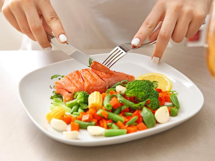The omega-3s in salmon and the anti-inflammatory properties of vegetables can help reduce the symptoms of endometriosis.