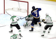 St. Louis Blues' Pat Maroon (7) scores the game-winning goal past Dallas Stars goaltender Ben Bishop, as Miro Heiskanen (4) and John Klingberg (3) help defend during the second overtime in Game 7 of an NHL second-round hockey playoff series Tuesday, May 7, 2019, in St. Louis. The Blues won 2-1 to win the series. (AP Photo/Jeff Roberson)