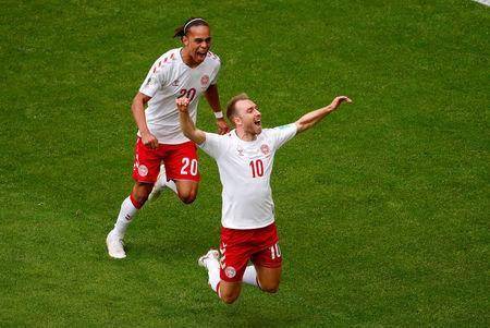 Denmarks Christian Eriksen celebrates with Yussuf Poulsen after scoring their first goal. REUTERS/David Gray