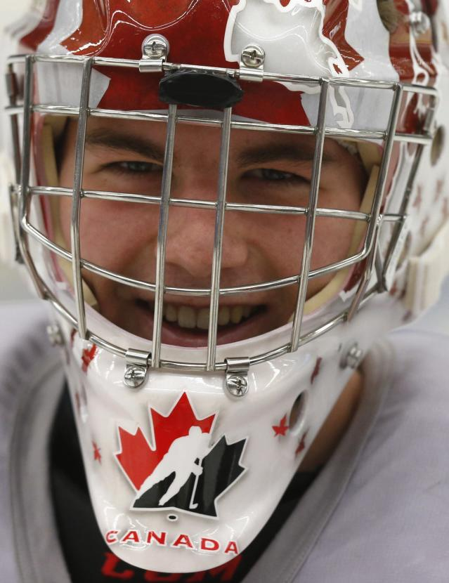 Canada's goalie Jake Paterson smiles during team practice for the IIHF World Junior Championship in Malmo December 27, 2013. REUTERS/Alexander Demianchuk (SWEDEN - Tags: SPORT ICE HOCKEY PROFILE HEADSHOT)