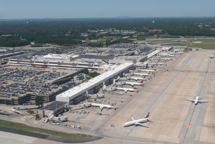 shutterstock_314376227 Aerial view of Hartsfield-Jackson Atlanta International Airport. The Atlanta airport serves 89 million passengers a year, it is the world's busiest airport. airplane, aircraft, flying