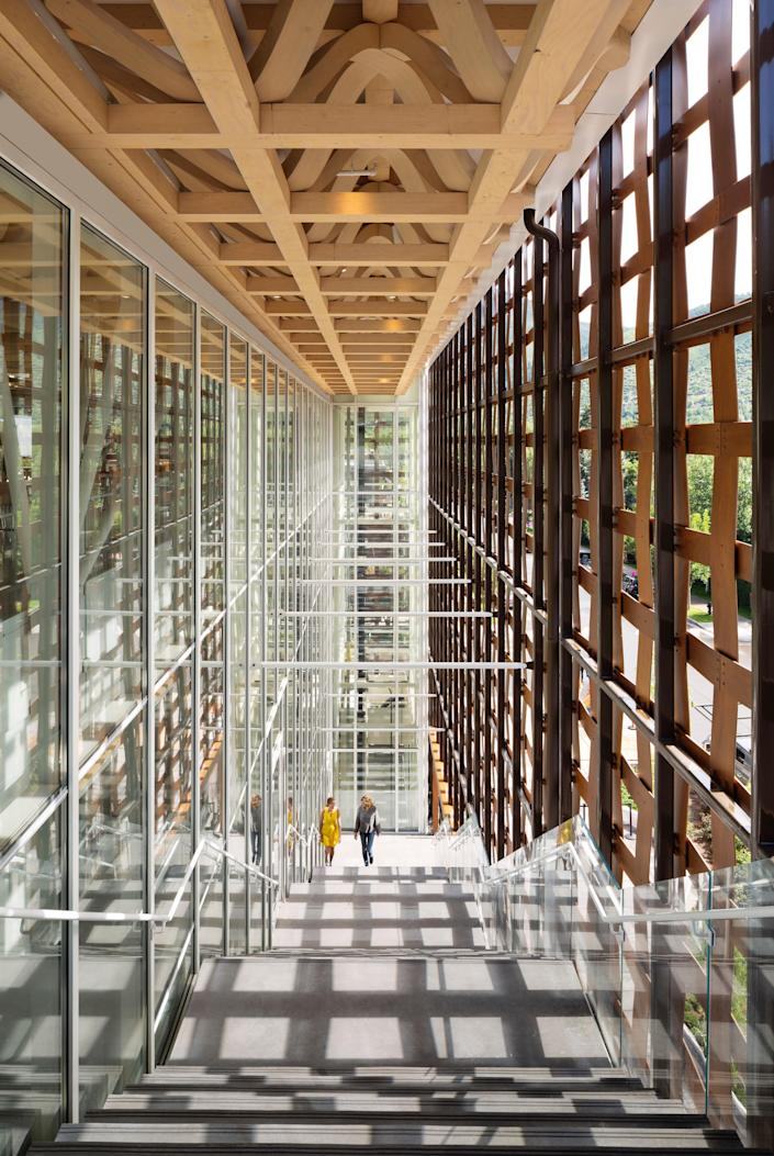The staircase of the Shigeru-Ban building in daylight at the Aspen Art Museum.