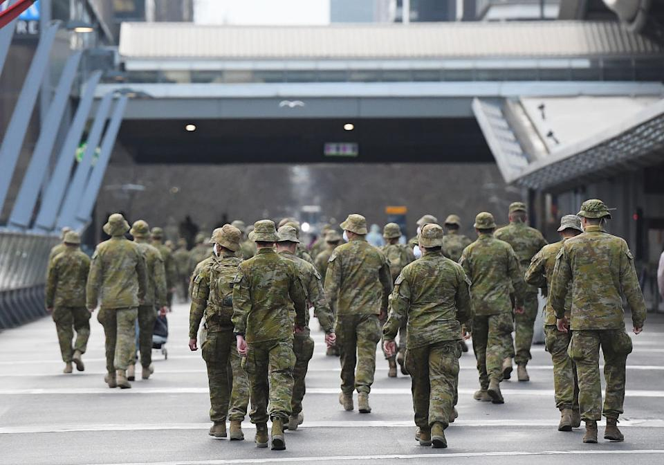 Members of the Australian Defence Force walk through the city in Melbourne, Australia.