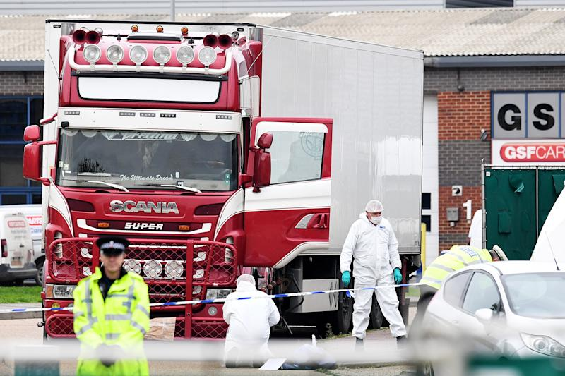THURROCK, ENGLAND - OCTOBER 23: Police and forensic officers investigate a lorry in which 39 bodies were discovered in the trailer, as they prepare move the vehicle from the site on October 23, 2019 in Thurrock, England. The lorry was discovered early Wednesday morning in Waterglade Industrial Park on Eastern Avenue in the town of Grays. Authorities said they believed the lorry originated in Bulgaria. (Photo by Leon Neal/Getty Images)