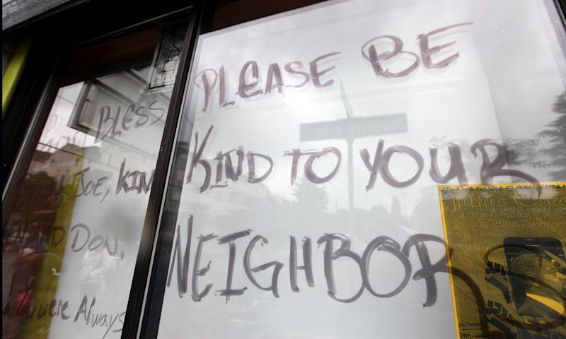 A message is written on paper covering the window at the front of a cafe where a gunman killed four people and severely wounded another a day earlier, Thursday, May 31, 2012, in Seattle. Police say the assailant later killed a woman during a carjacking before shooting himself. As officers closed in during a widespread manhunt on Wednesday, the suspect put a gun to his head and pulled the trigger and later died at a hospital. (AP Photo/Elaine Thompson)