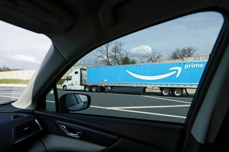 Amazon, which has ramped up hiring during the pandemic, will offer full-time jobs to 125,000 of its 175,000 temporary hires (AFP Photo/Patrick Smith)