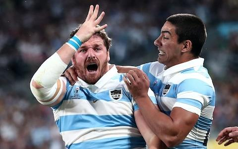 Argentina's hooker Julian Montoya (L) reacts after scoring a try during the Japan 2019 Rugby World Cup Pool C match between France and Argentina at the Tokyo Stadium in Tokyo on September 21, 2019 - Credit: Getty Images