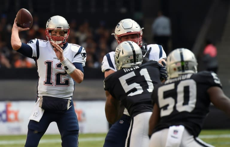 Tom Brady completed 30-of-37 passes for 339 yards and three touchdowns to spark the defending champion New England Patriots over Oakland 33-8 at Mexico City