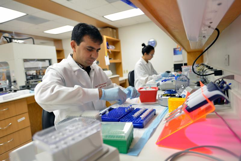 "In this June 14, 2013 photo provided by the Baylor College of Medicine, researchers prepare reagents for the DNA sequencing of patient samples on the school's campus in Houston. In a study published Wednesday, Oct. 2, 2013 in the New England Journal of Medicine, scientists say they were able to crack a quarter of mystery diseases that had stumped doctors for years by decoding the patients' genes. The study is the first large-scale effort to move gene sequencing out of the lab and into ordinary medical care, and it shows that high hopes for this technology are finally paying off. ""This is a direct benefit of the Human Genome Project,"" the big effort to decode our DNA, said Dr. Christine M. Eng of Baylor College of Medicine in Houston. ""We're now able to directly benefit patients through more accurate diagnosis."" (AP Photo/Baylor College of Medicine, Agapito Sanchez)"
