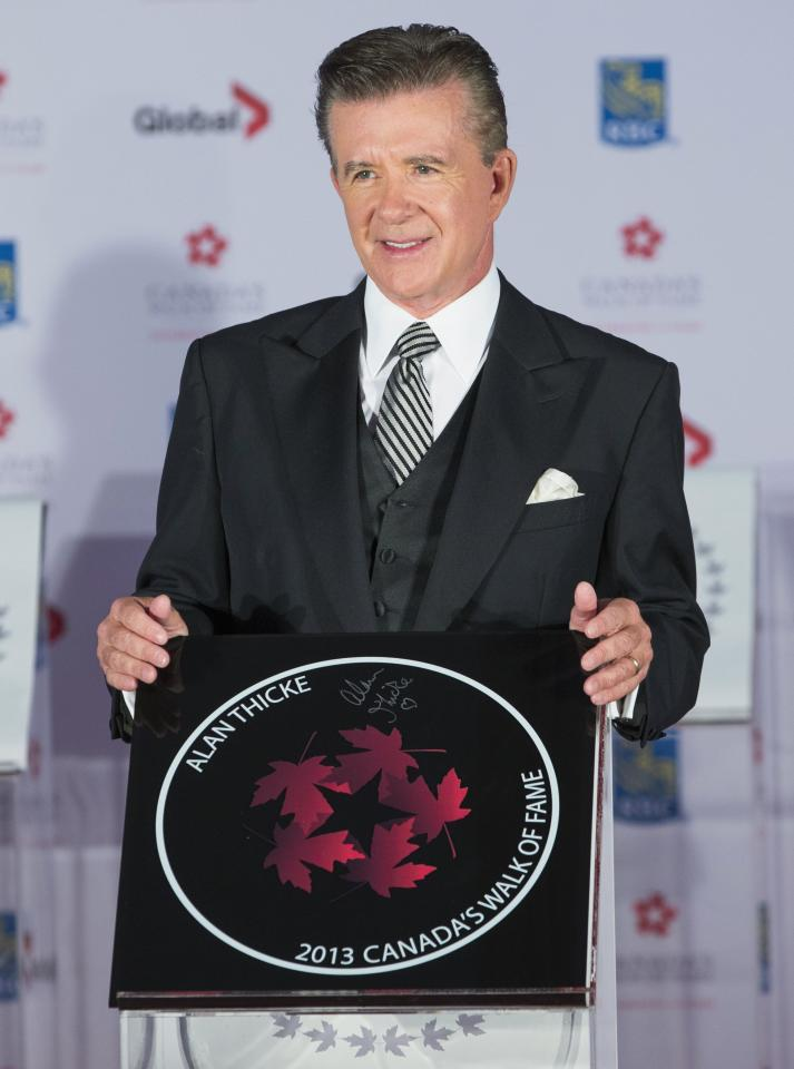 Actor Alan Thicke stands by his star during Canada's Walk of Fame induction ceremonies in Toronto, September 21, 2013. REUTERS/Mark Blinch (CANADA - Tags: ENTERTAINMENT)