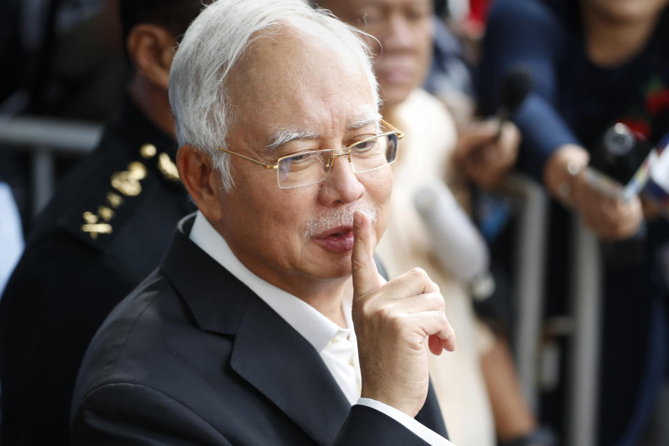 File - In this May 24, 2018, file photo, former Malaysian Prime Minister Najib Razak gestures as he leaves the Malaysian Anti-Corruption Commission (MACC) Office in Putrajaya, Malaysia. After years of insisting on his innocence, Najib learns his fate this week in his first corruption trial linked to one of the world's biggest financial scandals - a verdict widely seen as a test for the rule of law five months after a new government took power. July 28, 2020's ruling is being closely watched amid a stunning reversal of fortune for Najib's Malay party, which returned to office as a key player in the new ruling alliance. (AP Photo/Vincent Thian, File)